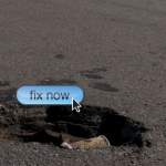 Pothole in street with Fix Now sign