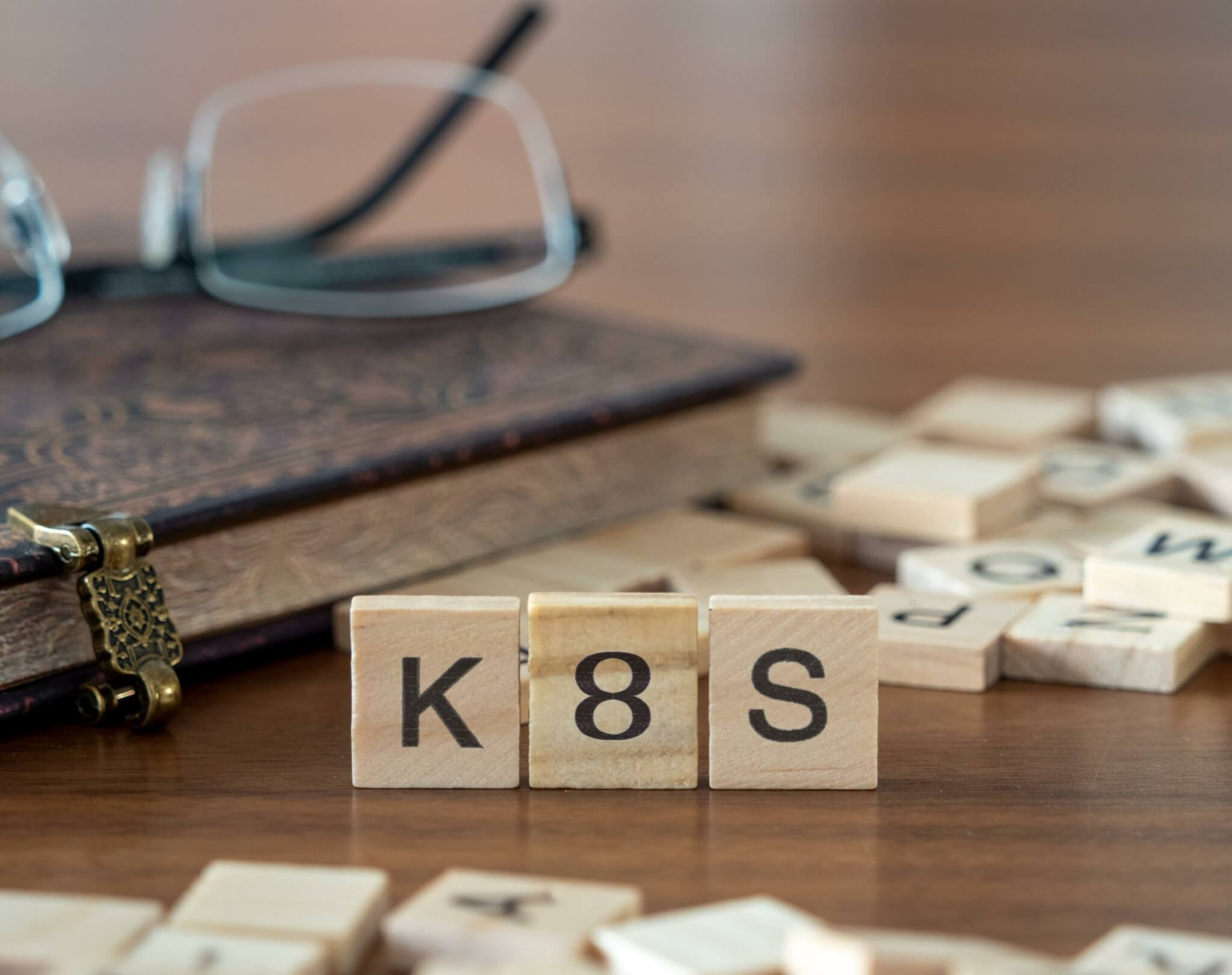 The acronym k8s for kubernetes  concept represented by wooden letter tiles